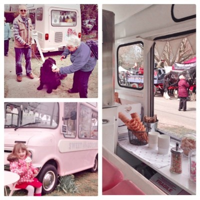 visitors eating their ice cream next to van