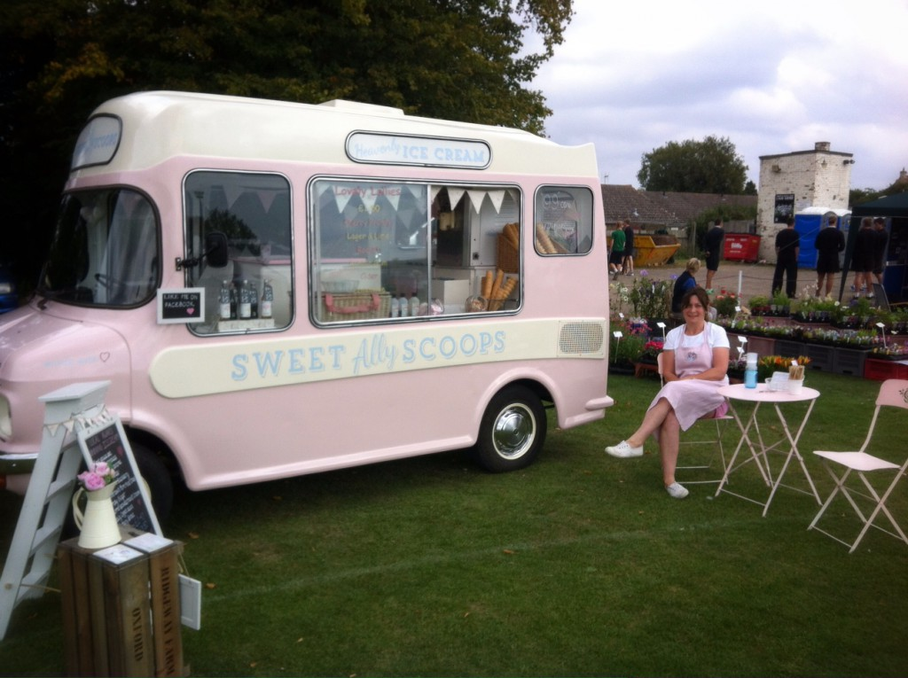 Ally sitting next to Lottie her pink ice cream van