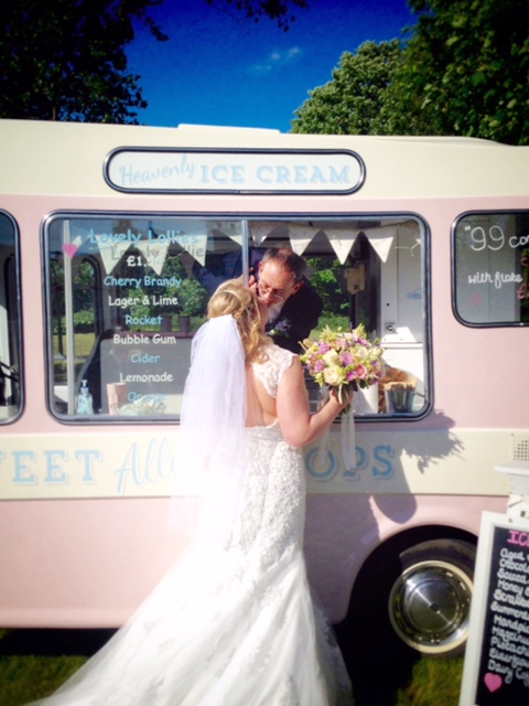 June bride at her June wedding next to ice cream van