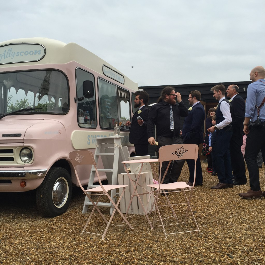 guests in line for ice cream from van