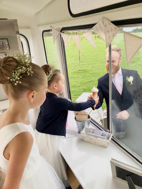 Bridesmaid serving ice cream